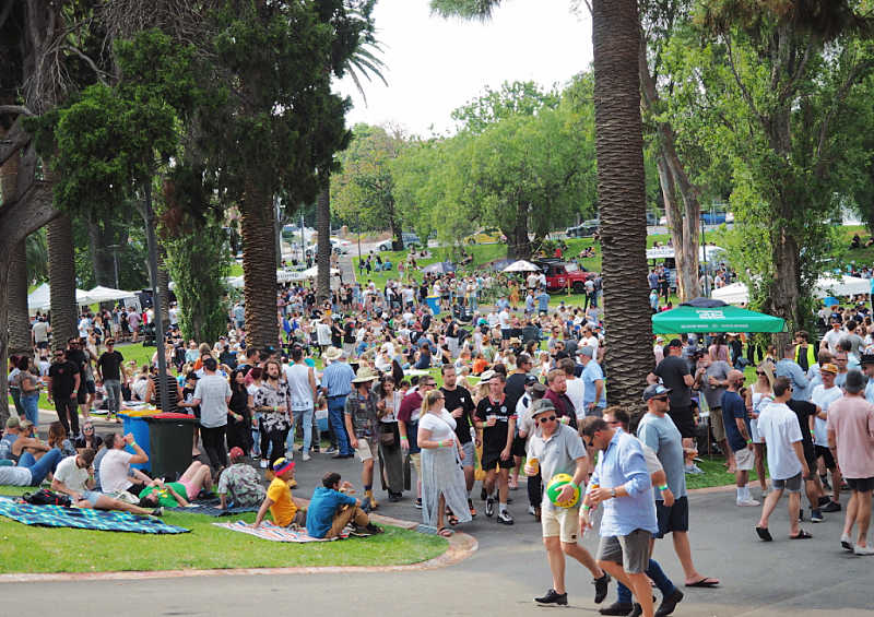 People sitting and walking amongst the trees at The Great Australian Beer Festival.