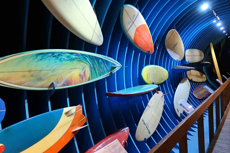 Wall of colourful surfboards at the Australian National Surfing Museum.