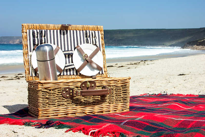 Picnic basket and rug at the beach in Australia.