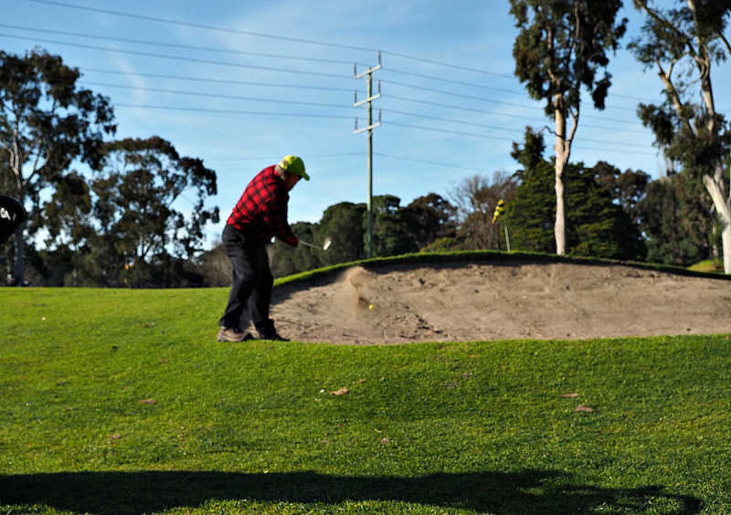 Bunker and golfer at one of the many golf clubs Geelong has.