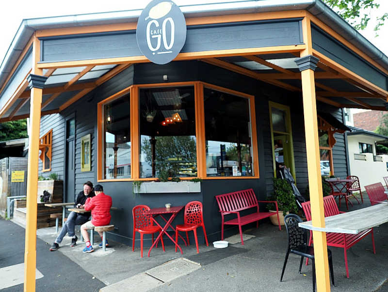 Two people drinking coffee at the outdoor tables at Cafe Go Geelong