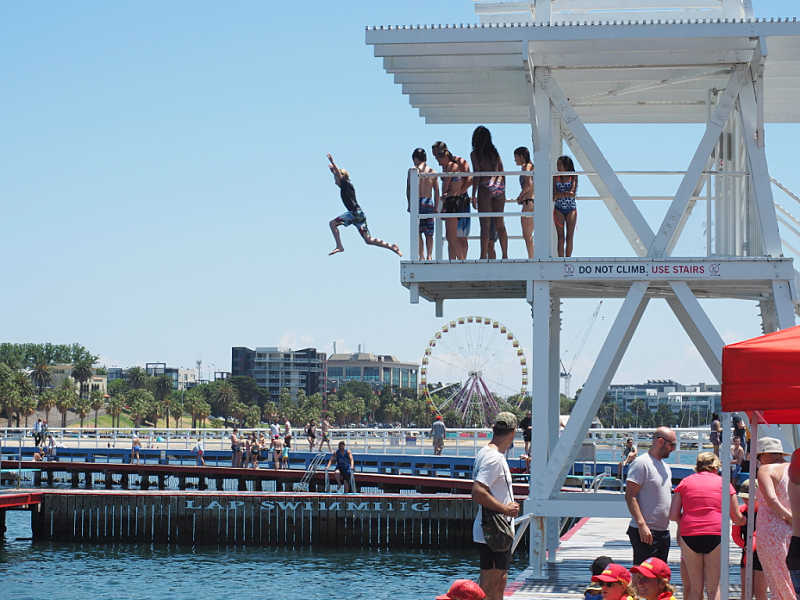 Boy jumping off the Eastern Beach dive tower.