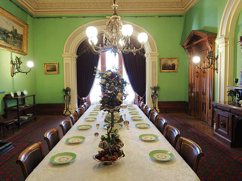 Werribee Mansion formal dining room with place settings and chandelier.