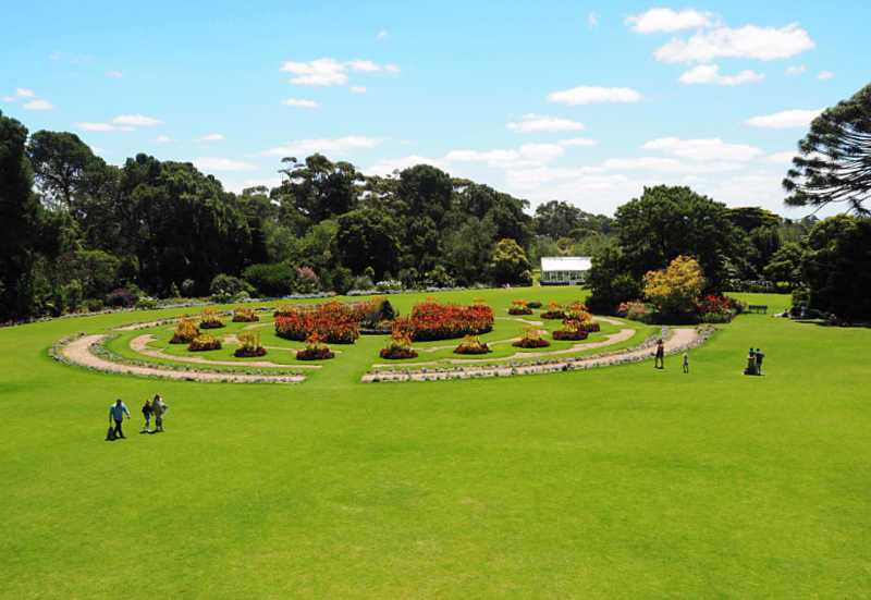 View of people strolling the lawns at the Werribee Park Mansion and formal gardens