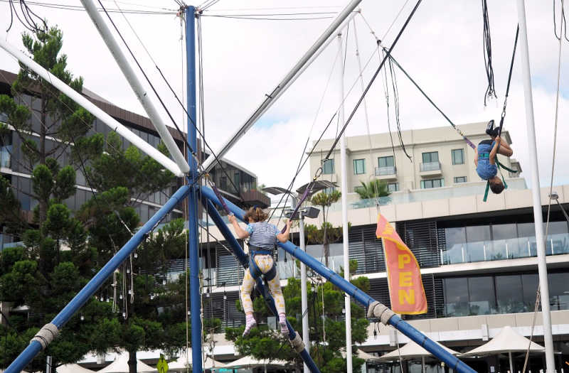 Kids doing somersaults on the Geelong Bungy Trampoline.