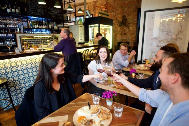 Patrons drinking a toast at Geelong cellar door.