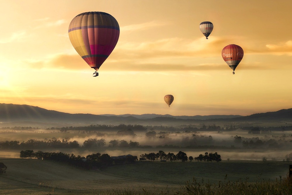 Hot air balloons at sunrise.
