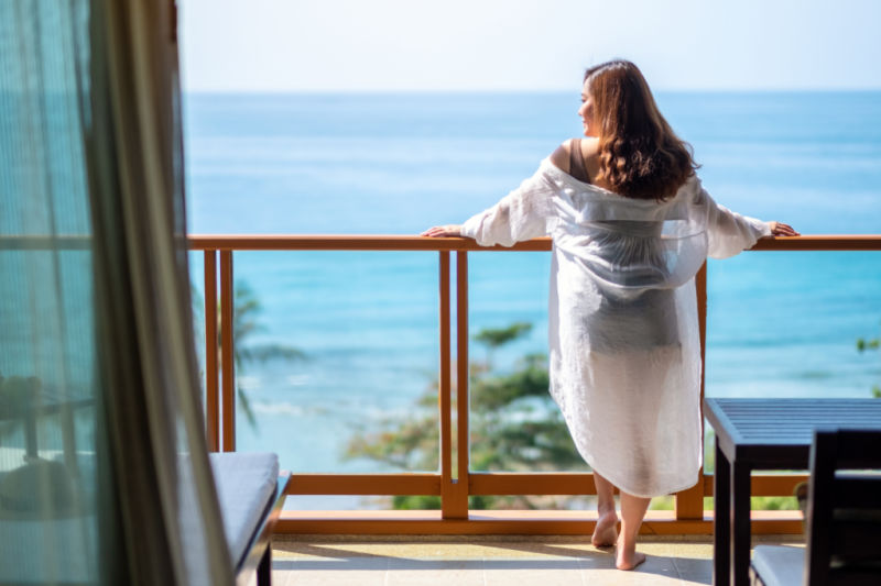 Woman enjoying the view from the best Lorne accommodation.
