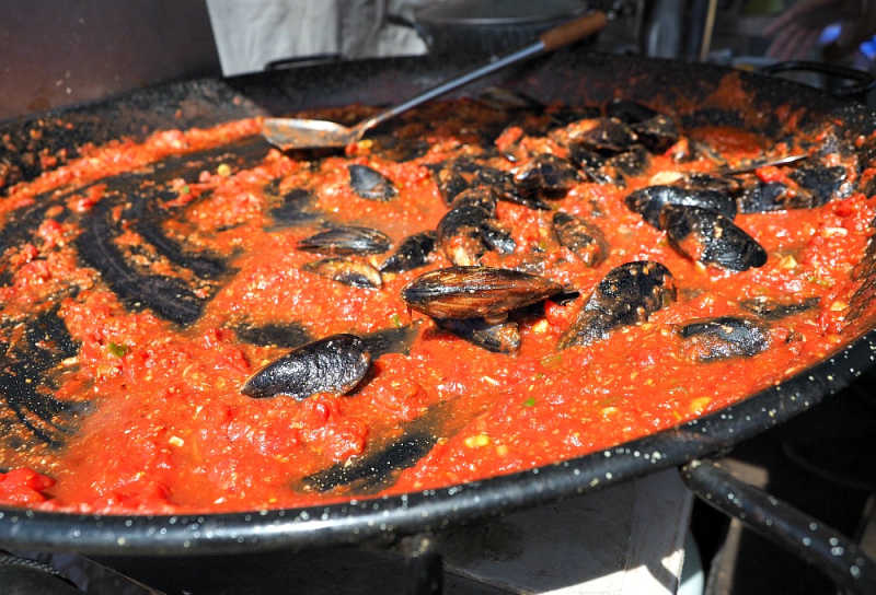 Mussels cooking in a tomato sauce at Portarlington Mussel Festival.