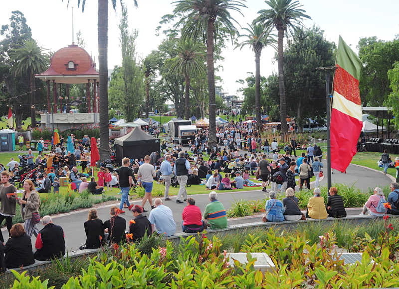 People and flag at the Nightjar Festival Geelong.