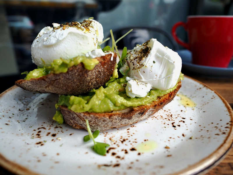 Smashed avocado and poached eggs breakfast at one of the many Pakington Street Cafes