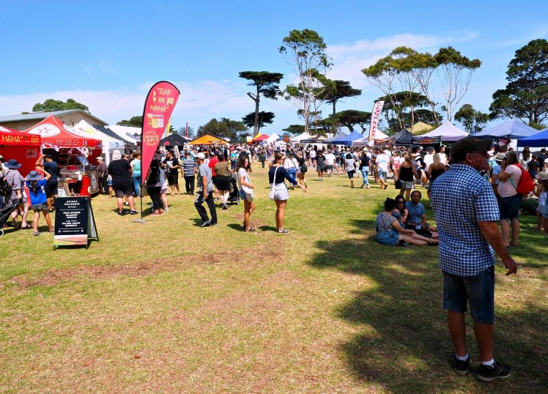 People and market stalls at the Portarlington Mussel Festival.