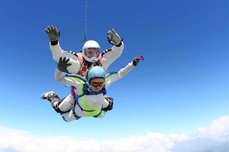 People tandem skydiving on the Great Ocean Road