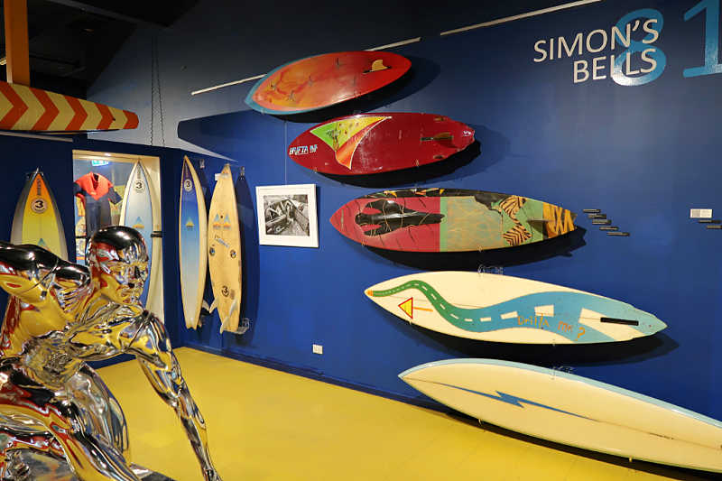 Surf museum Torquay sculpture and wall of surfboards.