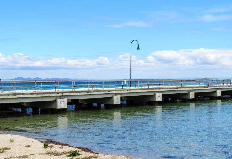 View of Portarlington pier with the You Yangs in the background.