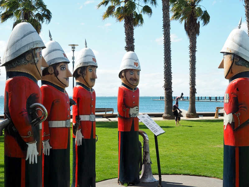 Volunteer Rifle Band Bollards on Geelong Waterfront with a person doing a handstand in the background.