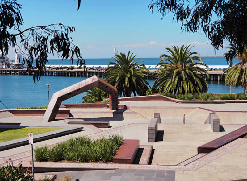 Geelong Skate Park with palm trees and Cunningham Pier in the background.