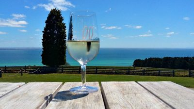 Glass of wine with views of the Bellarine